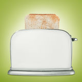 Bread toaster with toast Royalty Free Stock Images