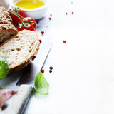 Bread, tomato, basil and olive oil Stock Photography