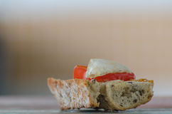 Bread, tomato and cheese. Ingredients in wood table Stock Photo