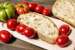 Bread and tomato. A classic and healthy combination: bread and tomato have a fundamental part in the Mediterranean diet. The tomato is native to the area of Stock Photos