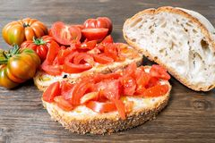 Bread and tomato. A classic and healthy combination: bread and tomato have a fundamental part in the Mediterranean diet. The tomato is native to the area of Stock Image