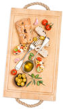 Bread with tomato, garlic and olives on the wooden board Stock Images