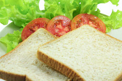 Bread. And tomato and Lettuce Stock Images