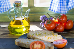 Bread with tomato and oil Stock Photography