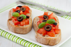 Bread with tomato, olives Stock Image