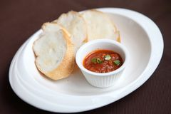 Bread with tomato sauce. On a plate royalty free stock photos