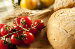 Bread and tomato. On the table Royalty Free Stock Photography