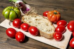 Bread, tomato and Tropea onion. A classic and healthy combination, bread, tomato and onion have a fundamental part in the Mediterranean diet Stock Photography
