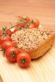 Bread and tomatoes Stock Photos