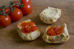 Bread with tomatoes on chopping board. Frise, friselle. Puglia Friselle with tomatoes on wooden cutting board Royalty Free Stock Photos