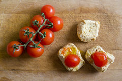 Bread with tomatoes on chopping board. Frise, friselle. Puglia Friselle with tomatoes on wooden cutting board Royalty Free Stock Photo