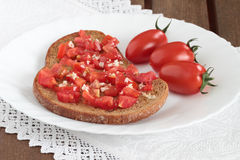 Bread ,tomatoes end garlic Royalty Free Stock Photos