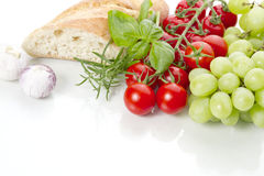 Bread, tomatoes and grapes Stock Photography