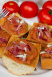 Bread with tomatoes and jamon close up Stock Images