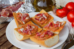 Bread with tomatoes and jamon Royalty Free Stock Image