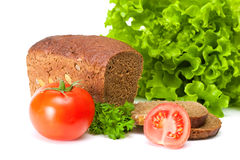 Bread with tomatoes and salad. On white background Royalty Free Stock Photos