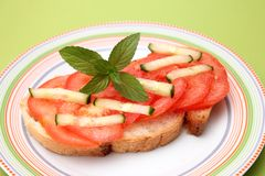 Bread with tomatoes Royalty Free Stock Image
