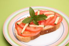 Bread with tomatoes Stock Image