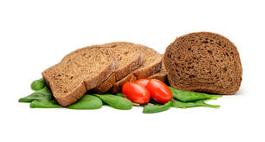 Bread tomatos and spinach Stock Photography