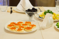 Bread topped with caviar on a buffet table Stock Images