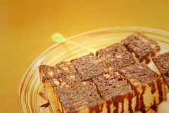 Bread topped with chocolate in a plate Royalty Free Stock Image