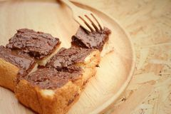 Bread topped with chocolate in a plate Royalty Free Stock Images