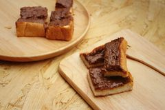Bread topped with chocolate in a plate Stock Photography