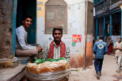 Bread trader sells bread on the narrow streets Royalty Free Stock Images