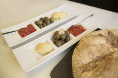 Bread. Typical spanish snack with bread, tomatoes sauce, garlic sauce and olives Royalty Free Stock Photo