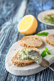 Bread with tzatziki on the white wooden board on the blue table vertical. Bread with tzatziki on the white wooden board on the blue  wooden table vertical Stock Photography