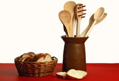 Bread and Utensils. Kitchen utensils in jar with slices of bread Royalty Free Stock Image