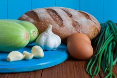 Bread, vegetable marrow in rural or rustic kitchen Royalty Free Stock Photos