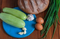 Bread, vegetable marrow in rural or rustic kitchen Royalty Free Stock Photo