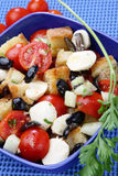 Bread and vegetable salad. In blue bowl Stock Photo