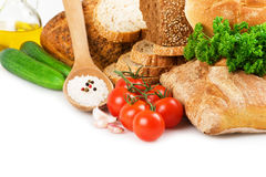 Bread and vegetables. Bread, vegetables, olive oil and spices Stock Photos