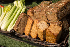 Bread and vegetables. In the brown basket on sunny day Royalty Free Stock Photos