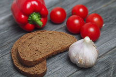 bread and vegetables. pepper tomato cherry and garlic on wooden Stock Photography