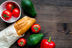Bread and vegetables on wooden desk background top view mock-up Royalty Free Stock Photography