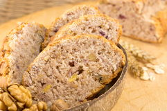 Bread with walnuts and raspberries Stock Photo