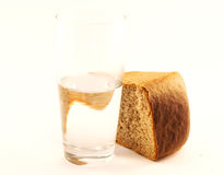 Bread and water. Glass of water and bread isolated against the white background stock images