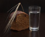 Bread and water Stock Photography