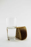 Bread and water 3. Glass of water and bread isolated against white background Stock Photography