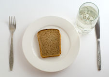 Bread and water Stock Photos
