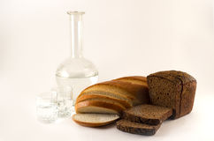 Bread and water. Wheat and rye bread sliced liquid in a glass jar on a white background Royalty Free Stock Image