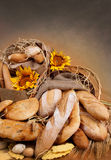 Bread and wheat. Group of bread, sweet, wheat and sunflower royalty free stock photo