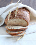 Bread and wheat. On the table Royalty Free Stock Photography