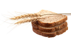 Bread and wheat. On a white background royalty free stock images