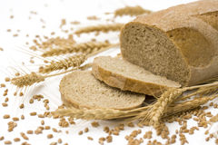 Bread and wheat. Bread, wheat ears and grain seeds on white background royalty free stock images