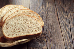 Bread with wheat bran on table Stock Images