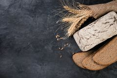 Bread and wheat ears. On dark background stock photo
